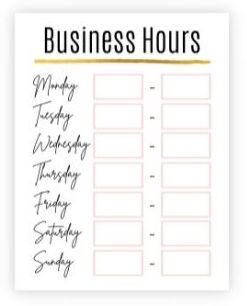 Business hours sign with gold and light pink